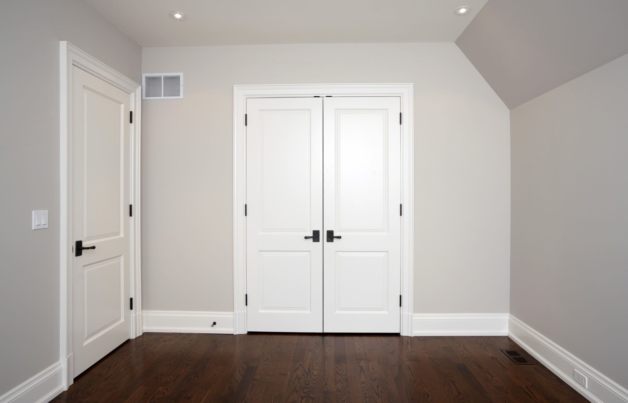 Door with wide wood trim and wide baseboards